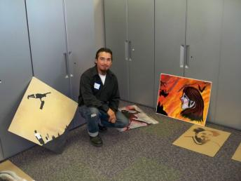 Student posing with his art work